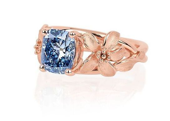 World of Diamonds 2.08 carat blue diamond ring with rose-gold plated platinum band. Luxury Lifesty says this can be auctioned at over $2 million.